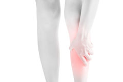 Acute pain in a woman shin isolated on white background. Clipping path on white background. Royalty Free Stock Photography