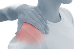 Acute pain in a woman shoulder. Royalty Free Stock Image