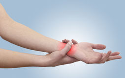 Acute pain in a woman wrist Royalty Free Stock Image