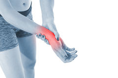 Acute pain in a woman wrist. Royalty Free Stock Photos