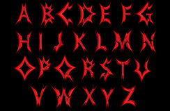 Acute red letters of the alphabet . Sharp , red letters on a black background .Alphabet Royalty Free Stock Photo