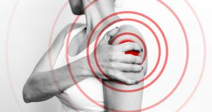 Acute shoulder pain. Hand touch the painful point, bnw image stock image