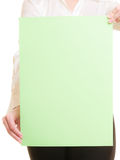 Ad. Blank banner in hands of businesswoman. Advertisement. Blank copy space green banner in hands of woman. Businesswoman recommending your product Stock Image