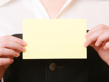 Ad. Blank card in hands of businesswoman Royalty Free Stock Photography