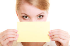 Ad. Businesswoman covering face with blank card Stock Photography
