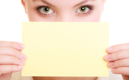 Ad. Businesswoman covering face with blank card Stock Image