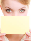 Ad. Businesswoman covering face with blank card Stock Images