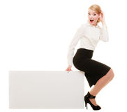 Ad. Businesswoman sitting on blank copy space banner Stock Image