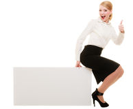 Ad. Businesswoman sitting on blank copy space banner Stock Images