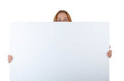 Ad cardboard with female smiling eyes Royalty Free Stock Photos