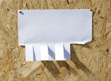 Ad with clips on wooden background. Royalty Free Stock Photography