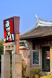 Ad of KFC, in a Chinese aged house. American fastfood, KFC, in a local featured Chinese aged traditional style house, in Xiamen city, Fujian, China, shown merge Royalty Free Stock Images