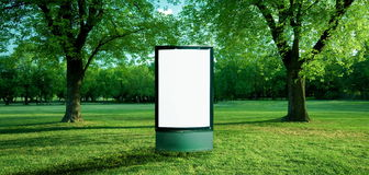 Ad panel in park Royalty Free Stock Photo