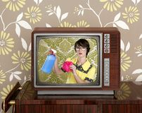 Ad tvl retro nerd housewife cleaning chores. Ad tv commercial retro nerd housewife cleaning chores wood television royalty free stock photos