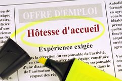 Hostess job offer in French. Ad working in a newspaper surrounded with a neon felt pen royalty free stock photos