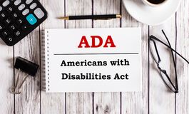 Free ADA Americans With Disabilities Act Is Written In A White Notepad Near A Calculator, Coffee, Glasses And A Pen. Business Concept Stock Image - 214733221