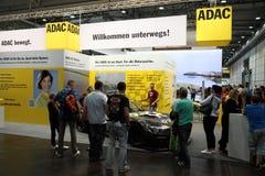 ADAC-ställning på den auto mobila internationella handeln Royaltyfri Foto