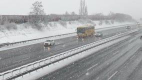 ADAC tour bus, heavy snowfall stock video footage