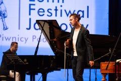 Adam Baldych - polnischer Violinist, der Live-Musik am Sommer Jazz Festival in Krakau spielt Lizenzfreie Stockfotografie