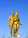 Adam and Eve. The golden statue of Adam and eve royalty free stock images