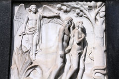 Adam and Eve. Milan, Italy. Old biblical scene sculpture at the Monumental Cemetery (Cimitero Monumentale). Religious art depicting Adam and Eve expulsion from Royalty Free Stock Image