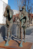Adam and Eve. Modern sculpture of Adam and Eve, ashamed and banished from Paradise, made by contemporary Slovene sculptor Jakov Brdar. The Butchers' bridge with Royalty Free Stock Images