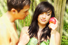 Adam and Eve. Are going to eat an apple Stock Images