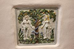 Adam and Eve ceramic tile. royalty free stock photo