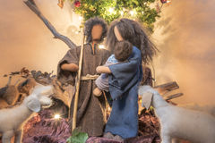 Adam and Eve at Christmas as fabric dolls and Christmas tree Royalty Free Stock Images