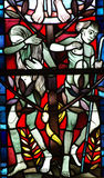 Adam and Eve expelled from Paradise. A stained glass photo of Adam and Eve Stock Images