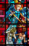 Adam and Eve expelled  from paradise. A stained glass photo of Adam and Eve expelled from paradise Stock Image