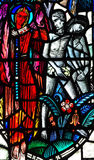 Adam and Eve expelled from paradise. A stained glass photo Adam and Eve expelled from paradise Stock Photography
