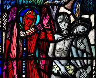 Adam and Eve expelled from paradise. A stained glass photo Adam and Eve expelled from paradise royalty free stock images