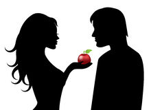 Adam and Eve and the forbidden fruit. RnSilhouettes of Adam and Eve with the forbidden fruit in hand Stock Image