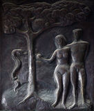 Adam and Eve, Illustrations of stories from the Bible on doors Basilica of the Annunciation in Nazareth. Illustrations of stories from the Bible on doors Stock Photography