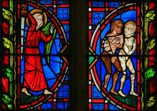 Adam and Eve - Stained Glass in Tours Cathedral. Stained glass window depicting Adam and Eve expelled from Paradise in the Cathedral of Tours, France Royalty Free Stock Photo