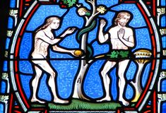 Adam and Eve on the stained glass window stock image