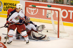 Adam Foote Watches The Puck Go Past Fredrik Norrena Stock Photography