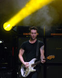 Adam Levin Concert. Adam Levine of Maroon 5 jamming during the concert tour Royalty Free Stock Photos
