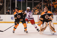 Adam McQuaid, Donald Brashear und Tim Thomas Stockfotos