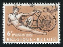 Adam, by Michelangelo, Broken Chain and UN Emblem. RUSSIA KALININGRAD, 20 OCTOBER 2015: stamp printed by Belgium, shows Adam, by Michelangelo, Broken Chain and royalty free stock photos