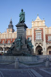 Adam Mickiewicz Monument and Cloth Hall in Krakow Stock Images