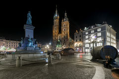 Adam Mickiewicz monument and St. Mary's Church in Krakow Royalty Free Stock Images