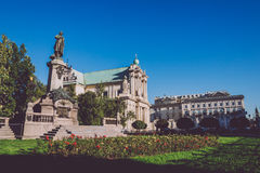 Adam Mickiewicz Statue and Carmelite Church in Warsaw. Adam Mickiewicz Monument and Carmelite Church in Warsaw, Poland. Church of the Assumption of the Virgin Royalty Free Stock Photos
