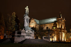 Adam Mickiewicz Statue and Church Assumption. Adam Mickiewicz Statue and Church of the Assumption of the Virgin Mary and of St. Joseph, Warsaw, Poland Royalty Free Stock Photography