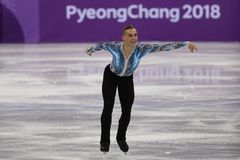 Adam Rippon of the United States performs in the Team Event Men Single Skating Free Skating at the 2018 Winter Olympics. GANGNEUNG, SOUTH KOREA - FEBRUARY 12 Stock Images