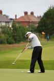 Adam Scott som sätter öppna 8th green för Golf 2012 Fotografering för Bildbyråer