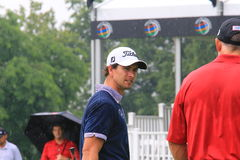 Adam Scott talks to his hitting coach. Pro golfer Adam Scott talks to his hitting coach after hitting the ball at a golf event Royalty Free Stock Photography