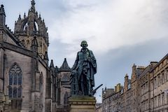 Adam Smith Statue and St Giles` Cathedral, Edinburgh, United Kingdom. Adam Smith Statue in front of St Giles` Cathedral in Edinburgh, United kingdom stock images