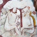 Adam und Eve sitzen unter dem Baum im Paradies und plaudern Lizenzfreies Stockbild